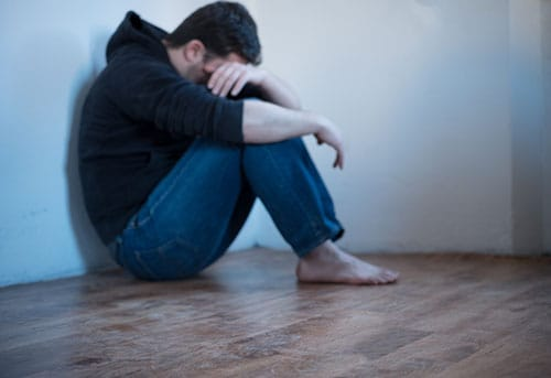 Young man despairing about heroin addiction and now methadone withdrawal